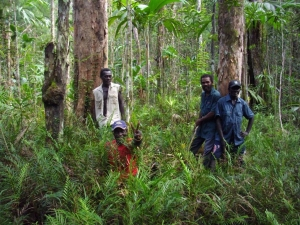 Stephen (second from right) with project area men in the Boeboe forest.